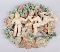 "A studio pottery panel of Adam, Eve and the serpent, 15"" high"