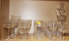 A part suite of Edwardian drinking glasses with cut and engraved decoration, and a thistle-shaped