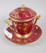 "A Limoges two handle cabinet cup, saucer and cover with gilt decoration and crimson ground, 7"" high"