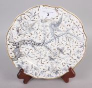 "A Rockingham dessert plate, decorated bird, tree and foliage in grey and gilt, 9"" dia, puce"