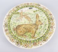 "A studio pottery charger with sgraffito decoration of hares, 14 1/2"" dia"