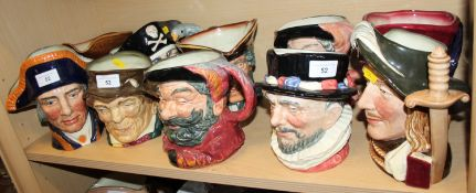 A collection of twelve Royal Doulton character jugs, including Lord Nelson, Beefeater, Aramis,