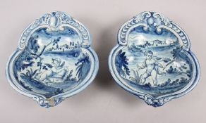 A pair of 19th century Cantagalli blue and white painted dishes with putto decoration (restored)