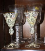 "A pair of Venetian enamel decorated wine glasses with octagonal bowls, 6"" high, and a set of four"