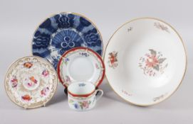 "An 18th century Delft plate with vase of flowers decoration, 8 1/2"" dia (rim chips), a cabinet cup"