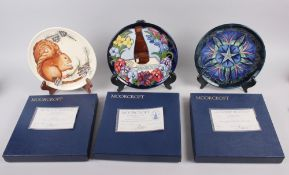 A Moorcroft edition Centennial plate and two Moorcroft year plates, 1995 and a 1996 boxed