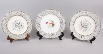 A pair of Rockingham porcelain dessert plates with grey and gilt decorated floral borders and