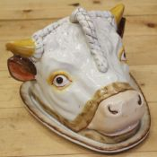 "A 19th century cheese dish, formed as a cow's head, 7 1/2"" high"