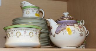 A Couldron green bordered gilt and wreath decorated part teaset and a Coalport floral decorated
