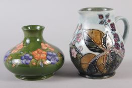 "A Moorcroft Sally Tuffin design floral squat vase, 4"" high, and a Moorcroft blackberry jug, 5 1/2"""