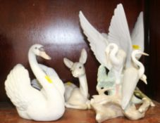 "A Lladro fawn, 6 1/2"" high, a Lladro turtledove, 11"" high, a Lladro swan, 7"" high, and a Nao heron"