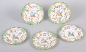 "Five late 19th century tea plates with floral decoration and green borders, 5 1/2"" dia"