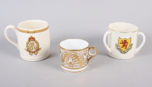 A 19th century Minton bone china gilt decorated coffee can with faux Sevres mark, a Goss tyg and a