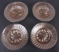 "Four Venetian aventurine gold and clear glass plates, 8 1/4"" dia"