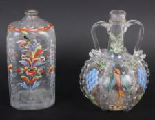 A 19th century glass bottle with carrying handles and enamelled bird and fruit decoration, 6 1/4""