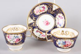 A New China Works bone china floral and gilt decorated trio with Lynn Rose collector's label