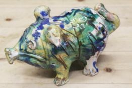 "An Italian majolica pig with splashed decoration, 10"" long"
