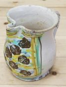 "An early 18th century Italian majolica water jug with sponged decoration, 6 1/2"" high"