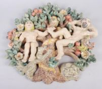 "A studio pottery panel of Adam, Eve and the serpent, 15"" high, and a studio pottery charger with"