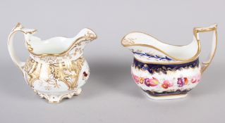 A Daniels type floral gilt decorated cream jug and a blue and floral panel decorated milk jug