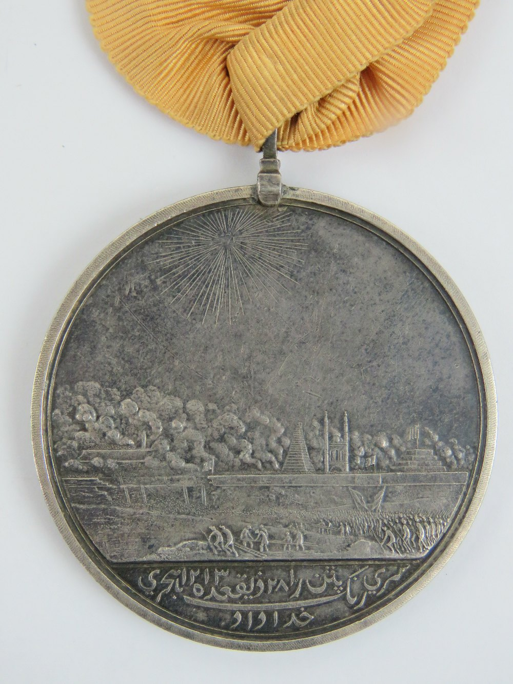 Lot 88 - An Honourable East India Company medal for Seringapatam 1799, with ribbon, silver, 48mm, Soho Mint.