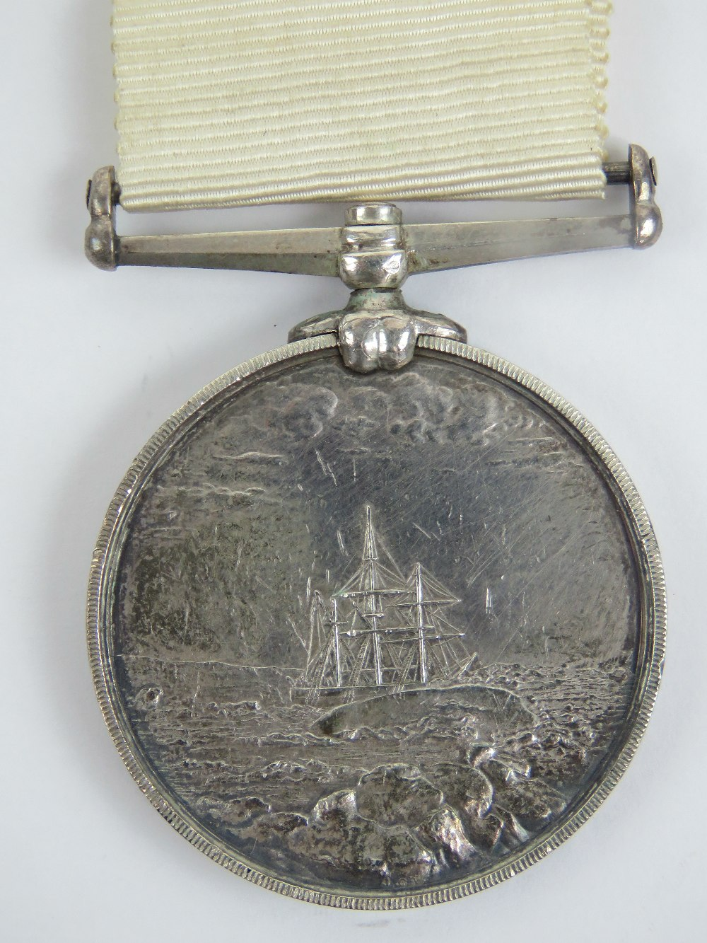Lot 30 - An Arctic medal with ribbon; British Arctic Expeditions of 1875-76, 'J. Cooper Pv OFFr 2 C? H.M.