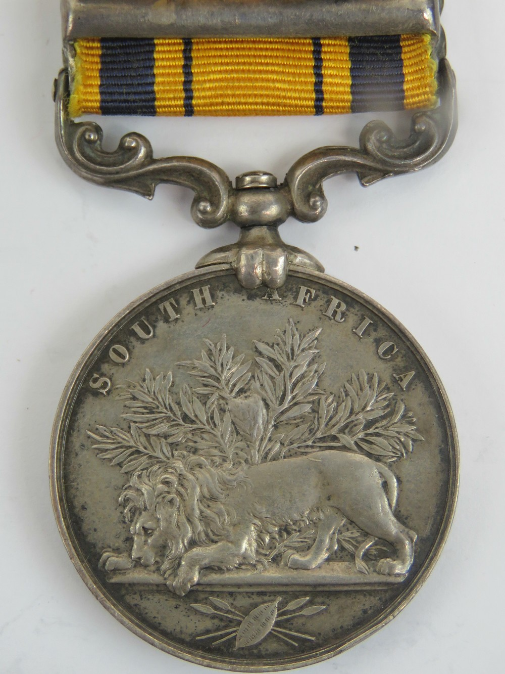 Lot 52 - A South African Zulu war medal (1880) with ribbon and bar for 1879,