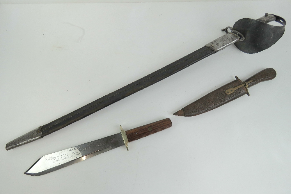 Lot 51 - A sword with leather sheath, an Oriental dagger in wooden sheath and a Bowie knife. Three items.