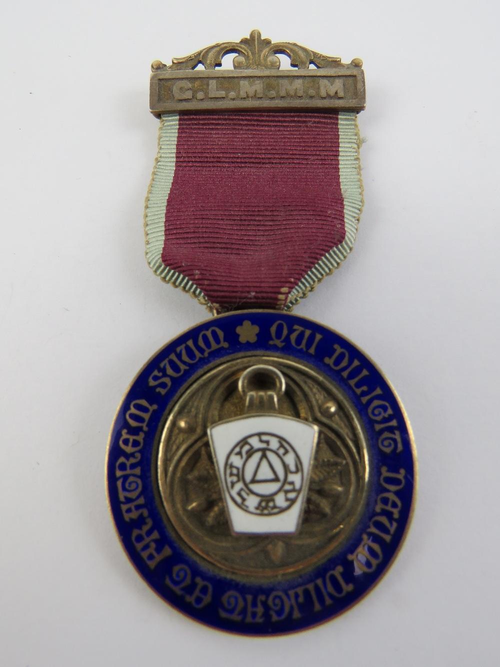 Lot 40 - A HM silver Grand Lodge Mark Master Masons jewel medal 'qui diligit deum diligat et fratrem suum'