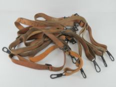 Nine WWII MG42 leather slings.