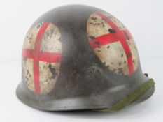 A reproduction US WWII medical helmet.