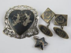 A small collection of silver niello jewe