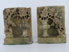 A pair of Oriental carved and pierced so
