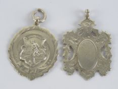 Two HM silver fob medallions, one of shi