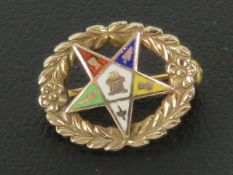 Masonic; A 10ct gold enamelled pentagram