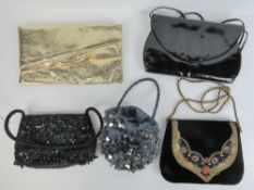 Two ladies beaded evening bags together with another in velvet having embroidery to front.