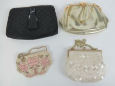 Two vintage ladies beaded evening bags together with two other evening bags. Four items.