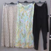 A 100% silk floral skirt by Artigiano, UK size 16.