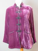 Ladies purple velvet jacket size L having mandarin collar with tie fastenings and two pockets.