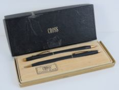 A Cross Classic Black ballpoint pen and pencil set in original box (box slightly a/f).