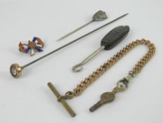 A 'Whitby' jet handled button hook, together with a hat pin, a white metal sheild shaped tie pin,