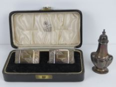 A pair of HM silver octagonal napkin rings, each hallmarked Birmingham 1952,