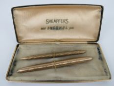A Sheaffer's 'new snorkel pen set' in box being fountain pen and propelling pencil, slightly a/f.