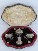 A superb HM silver cruet set in original fitted silk and velvet lined case, comprising pepper,