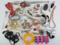 A quantity of assorted costume jewellery including a white stone cocktail bracelet by Monet,