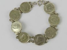 A 925 silver bracelet set with eight threepence coins 1917 - 194(0?), 19.5cm in length, 19.3g.