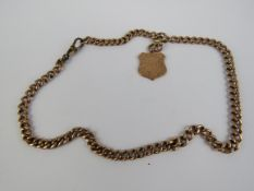 A 9ct rose gold curb link chain having gilt metal clasp and 9ct rose gold engraved shield fob upon.