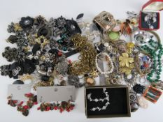 A quantity of costume jewellery including cut steel flower, malachite bead necklace and bangle,