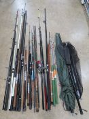 A quantity of assorted contemporary coarse fishing gear including rods, landing nets, umbrella,