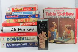 A quantity of assorted board games including Careers, Take the Test, Twister, Downfall,